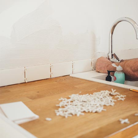 Laying Kitchen Tiles | Adam Peters Construction